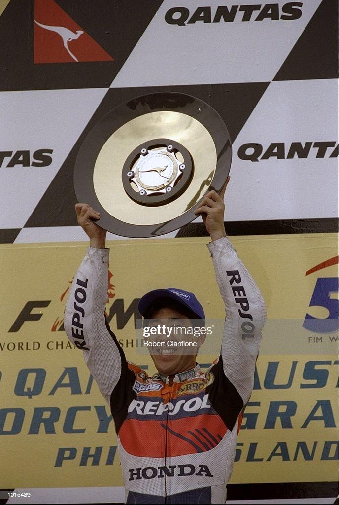 Tadayuki Okada of Japan lifts the trophy following his win in the 500cc race at the Australian Motorbike Grand Prix held at Phillip Island in Victoria, Australia. \ Mandatory Credit: Robert Cianflone /Allsport