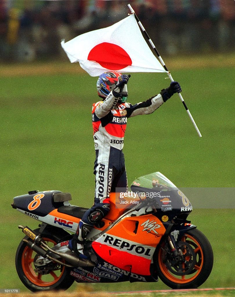 Tadayuki Okada #8 of Japan stands on his bike after taking victory in the 500cc class race at the 1999 Australian Motorbike Grand Prix at Phillip Island, Victoria, Australia. Mandatory Credit: Jack Atley/ALLSPORT