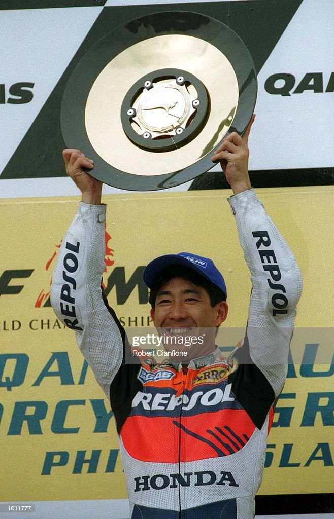 Tadayuki Okada #8 of Japan stands on the podium with the winners trophy after taking victory in the 500cc class race at the 1999 Australian Motorbike Grand Prix at Phillip Island, Victoria, Australia. Mandatory Credit: Robert Cianflone/ALLSPORT
