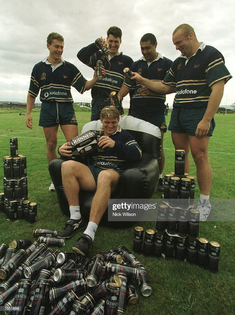 Tim Horan of Australia gets a bath of Guinness from teamates after winning a years supply of beer and 10000 pounds for a charity for scoring the fastest try in the first week of the Rugby World Cup, at the Portmarnock Sport Centre, Dublin, Ireland ahead of Australia's match against Ireland at Landsdowne Road on Sunday. Mandatory Credit: Nick Wilson/ALLSPORT