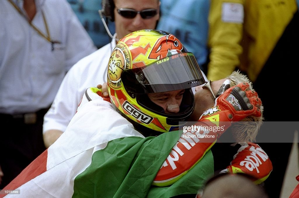 Valentino Rossi (left) hugs Italian compatriate Marco Melandri after their respective wins in the 250cc and 125cc races during the Australian Motorbike Grand Prix held at Phillip Island in Victoria, Australia. \ Mandatory Credit: Robert Cianflone /Allsport