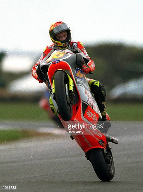 Valentino Rossi of Italy pulls a mono after taking victory in the 250cc class race at the 1999 Australian Motorbike Grand Prix at Phillip Island...