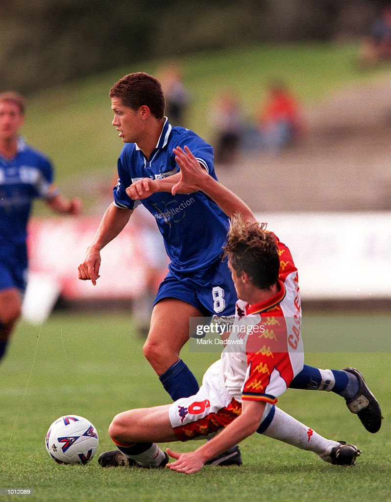 Vaughan Coveny #8 for South Melbourne keeps his feet as Luke Casserley #6 for Northern Spirit attempts to tackle him, during the game South Melbourne versus Northern Spirit, played at Bob Jane Stadium, Albert Park, Melbourne, Australia andwon by South Melbourne 2-0. Mandatory Credit: Mark Dadswell/ALLSPORT