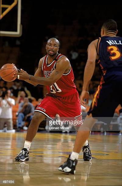 Voshon Lenard of the Miami Heat passes the ball during a PreSeason game against the Golden State Warriors at the Great Western Forum in Inglewood...