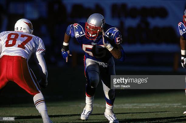 Willie McGinest of the New England Patriots runs up the field during a game against the Arizona Cardinals at the Sun Devil Stadium in Tempe Arizona...