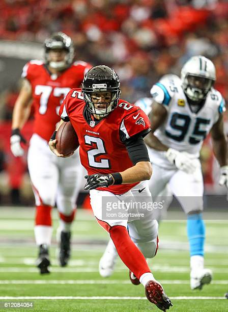 Atlanta Falcons quarterback Matt Ryan runs the ball for a first down during the first half of the NFL game between the Carolina Panthers and the...