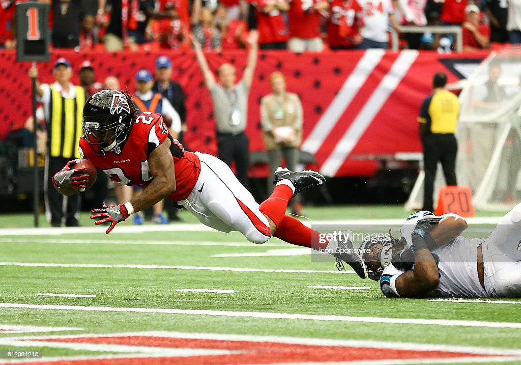 Atlanta Falcons running back Devonta Freeman (24) dives for the end zone during the first half of the NFL game between the Carolina Panthers and the Atlanta Falcons. The Falcons beat the Panthers 48 - 33 at the Georgia Dome in Atlanta, Georgia.