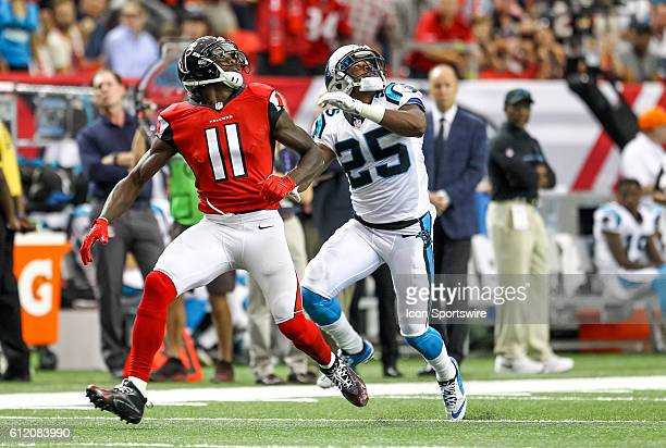 Atlanta Falcons wide receiver Julio Jones and Carolina Panthers cornerback Bene' Benwikere track a over thrown pass by Atlanta Falcons quarterback...