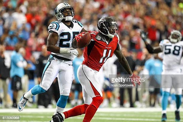 Atlanta Falcons wide receiver Julio Jones celebrates in the end zone during the first half of the NFL game between the Carolina Panthers and the...