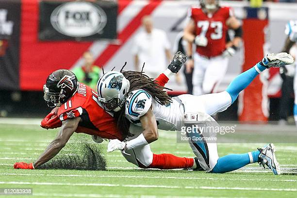 Carolina Panthers free safety Tre Boston tackles Atlanta Falcons wide receiver Julio Jones during the second half of the NFL game between the...