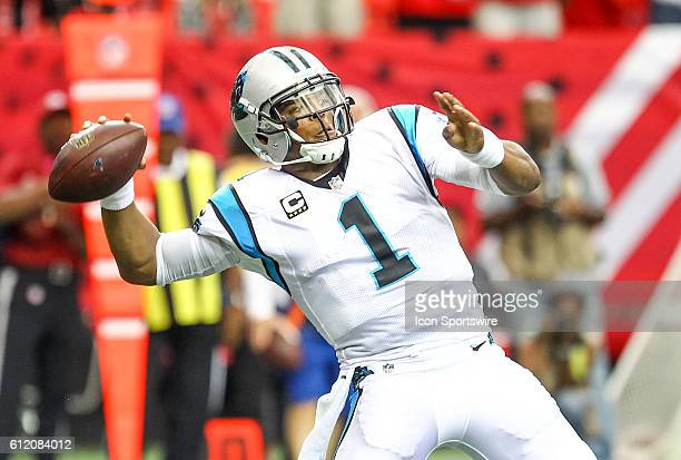Carolina Panthers quarterback Cam Newton throws the ball during the first half of the NFL game between the Carolina Panthers and the Atlanta Falcons...