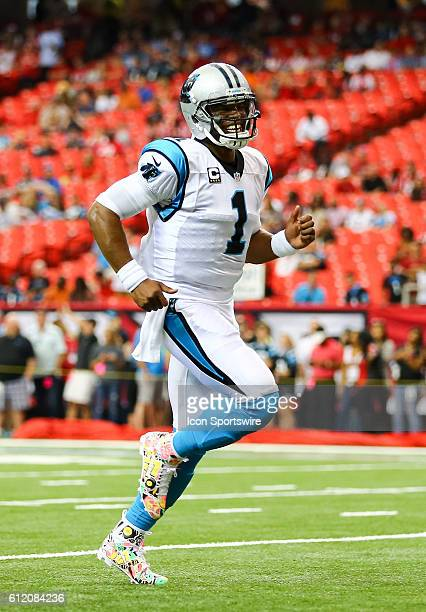 Carolina Panthers quarterback Cam Newton warms up before the NFL game between the Carolina Panthers and the Atlanta Falcons The Falcons beat the...