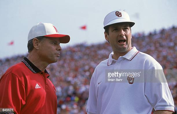 A close up of Head Coach Bob Stoops of the Oklahoma Sooners as he talks with Head Coach Frank Solick of the Nebraska Cornhuskers during the game at...