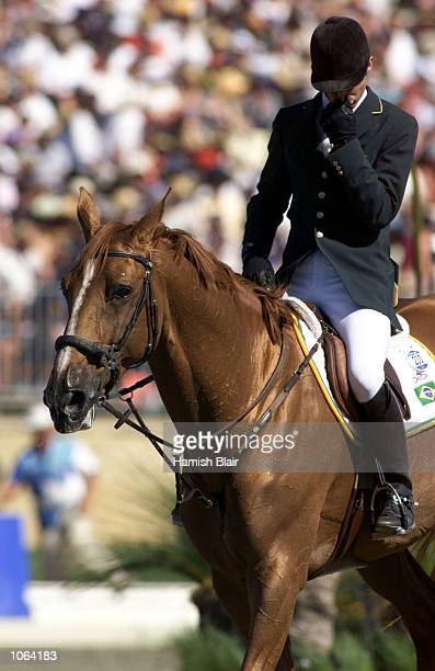 A dejected first round leader Rodrigo Pessoa of Brazil riding Baloubet Du Rou misses out on a medal after his horse refused to jump the eight fence...