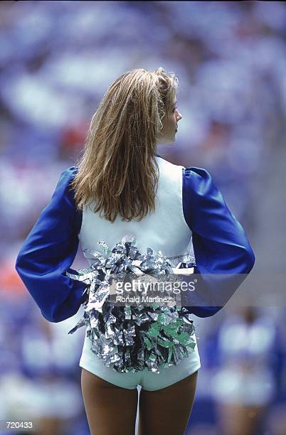 A general view of a Dallas Cowboys cheerleader performing during the game against the Arizona Cardinals at the Texas Stadium in Irving Texas The...