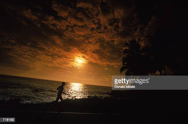 A silhouette of a runner at sunset during the Ironman Triathlon in KailuaKona HawaiiMandatory Credit Donald Miralle /Allsport