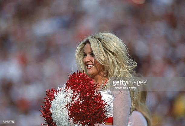 A view of a Phoenix Cardinals cheerleader performing during the game against theWashington Redskins at Sun Devil Stadium in Tempe Arizona The...