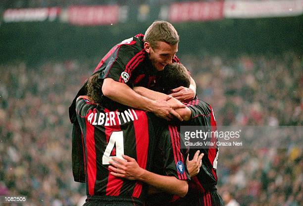 AC Milan celebrate during the Italian Serie A game against Juventus played at the San Siro Stadium in Milan Italy The game ended in a 22 draw...