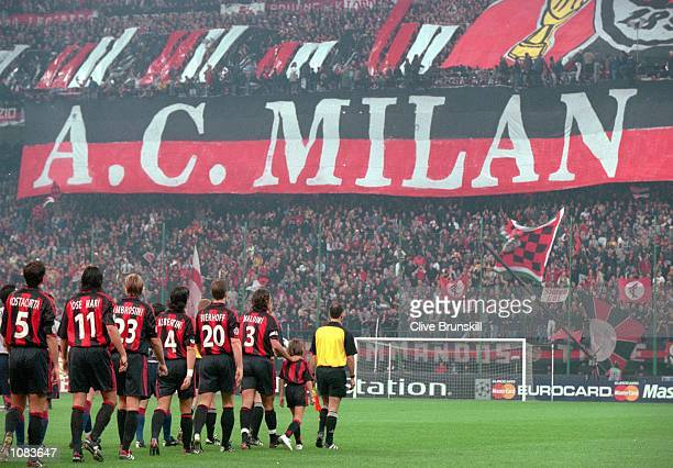 AC Milan walk out before the UEFA Champions League match against Barcelona at the San Siro in Milan Italy The match was drawn 33 Mandatory Credit...