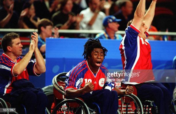 Ade Adepitan of Great Britain gets excited during the USA v Great Britain Men's Wheelchair Basketball Bronze Medal match as part of the 2000 Sydney...