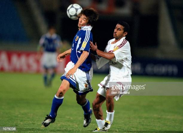 Akinori Nishizawa of Japan holds off Abdul Rahman Mahmoud of Qatar during the Asian Cup match played in Beirut Lebanon Mandatory Credit Ben Radford...