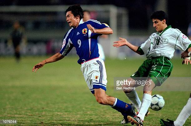 Akinori Nishizawa of Japan is tackled by Nanaf Al Temyat of Saudi Arabia during the Asian Cup Final match played in Beirut Lebanon Japan won the game...