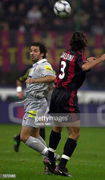 Alessandro del Piero of Juventus goes up for a header with Paolo Maldini of AC Milan during the Serie A match between AC Milan and Juventus at the...