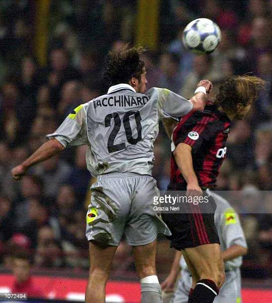 Alessio Tacchinardi of Juventus goes up for a header with Massismo Ambrosini of AC Milan during the Serie A match between AC Milan and Juventus at...