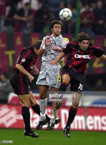 Alessio Tacchinardi of Juventus wins a header over Oliver Bierhoff and Zvonimir Boban of AC Milan during the Serie A match between AC Milan and...