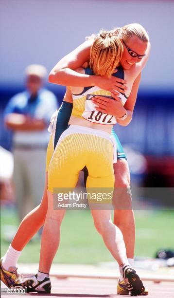 Alison Quinn is congratulated Katrina Webb of Australia after securing gold in the Womens 100m T38 Final at Stadium Australia during the Sydney 2000...