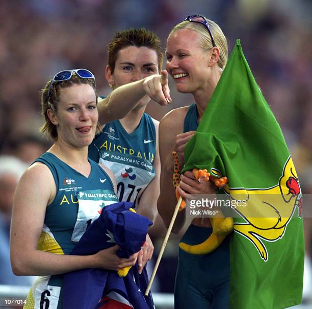 Alison Quinn Lisa McIntosh and Katrina Webb of Australia celebrate their medal wins in the Womens 200m T38 Final at the Sydney 2000 Paralympic Games...