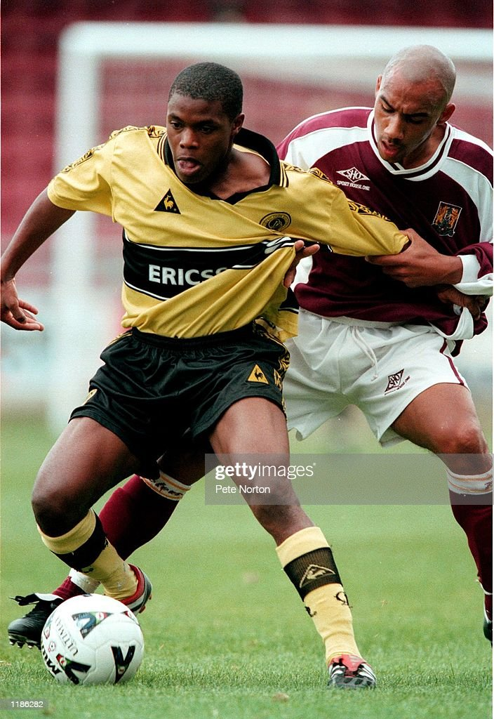 Alvin Bubb of Queens Park Rangers reserves holds off Nathan Meade ...