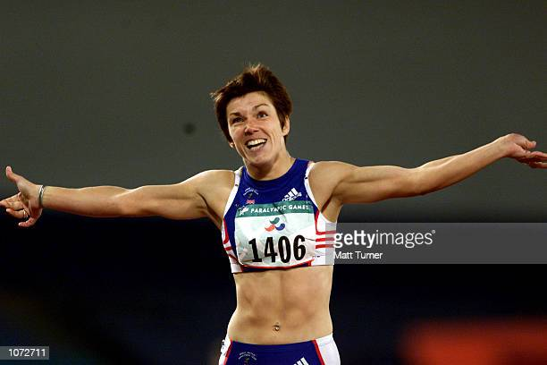 Caroline Innes of Great Britain celebrates after winning Gold in the Women's 400m T36 Final at Olympic Park during the Sydney 2000 Paralympics Sydney...