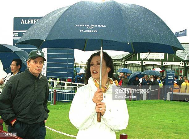 Cathrine Zeta Jones and Michael Douglas walk together to the 1st tee during the ProAm of the Alfred Dunhill Cup played on the Old Course at St...