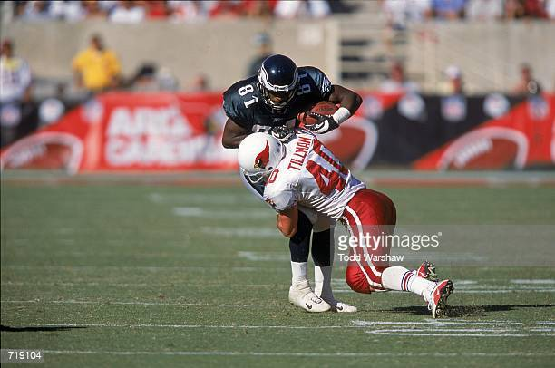 Charles Johnson of the Philadelphia Eagles gets tackled by Pat Tillman of the Arizona Cadinals during the game at the Sun Devil Stadium in Tempe...