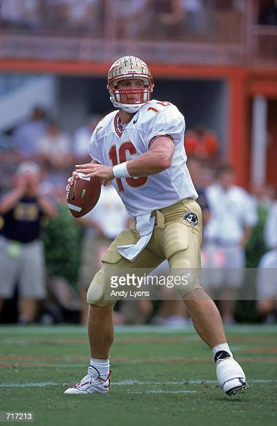 Chris Weinke of the Florida State Seminoles drops back to pass during the game against the Miami Hurricanes at the Orange Bowl in Miami, Florida. The...