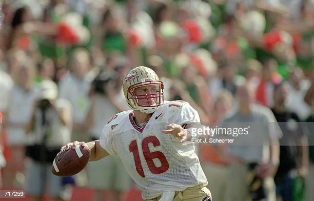 Chris Weinke of the Florida State Seminoles passes the ball during the game against the Miami Hurricanes at the Orange Bowl in Miami Florida The...