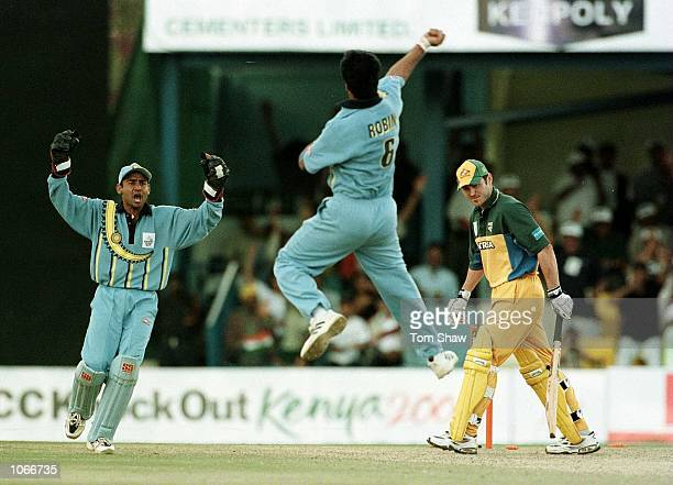 Damien Martyn of Australia is bowled out by Robin Singh of India during the Australia v India second round match of the ICC Knockout tournament at...