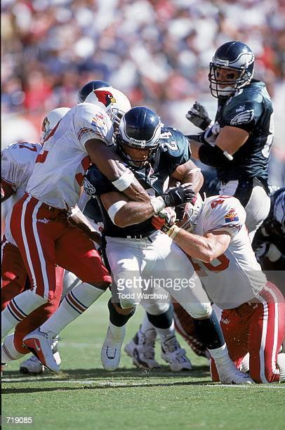 Darnell Autry of the Philadelphia Eagles gets pulled down by Pat Tillman of the Arizona Cadinals during the game at the Sun Devil Stadium in Tempe...