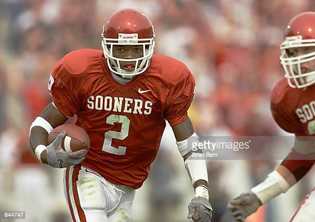 Defensive back Derrick Strait of the Oklahoma Sooners takes off running after intercepting quarterback Eric Crouch's pass of the Nebraska Cornhuskers...