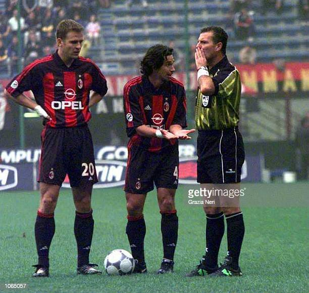 Demetrio Albertini of AC Milan appeals to the referee as teammate Oliver Bierhoff looks on during the Serie A league match between AC Milan and...