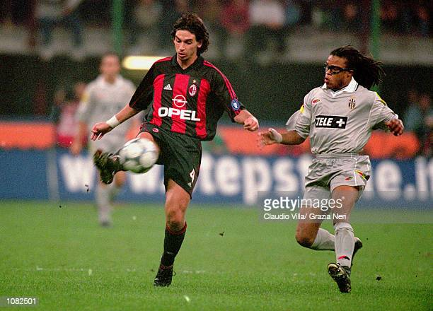 Demetrio Albertini of AC Milan is closed down by Edgar Davids of Juventus during the Italian Serie A game played at the San Siro Stadium in Milan...