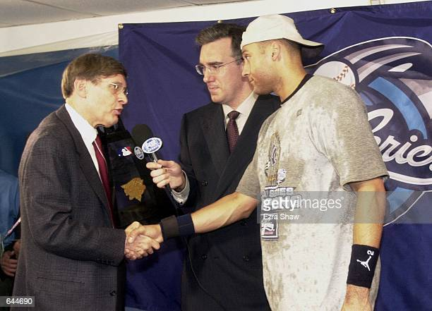 Derek Jeter of the New York Yankees is awarded the MVP trophy by commissioner Bud Selig after the Yankees defeated the New York Mets 42 during Game 5...