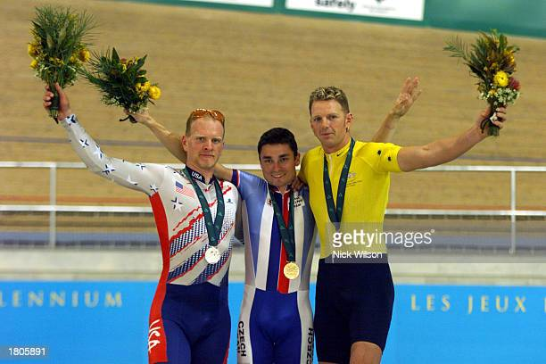 Dory Selinger of USA Jiri Jezek of Czech Republic and Paul Lake of Australia celebrate on the podium after the Mixed 1 Kilometre Time Trial LC2 Final...