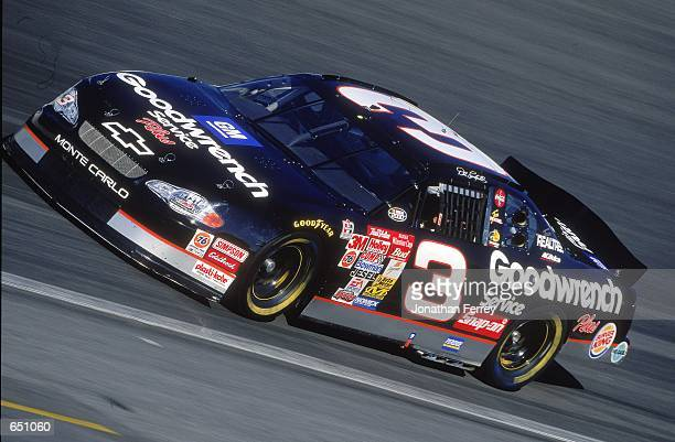 Driver Dale Earnhardt speeds down the track during the UAWGM 500 presented by NAPA part of the NASCAR Winston Cup Series at the Lowes Motor Speedway...