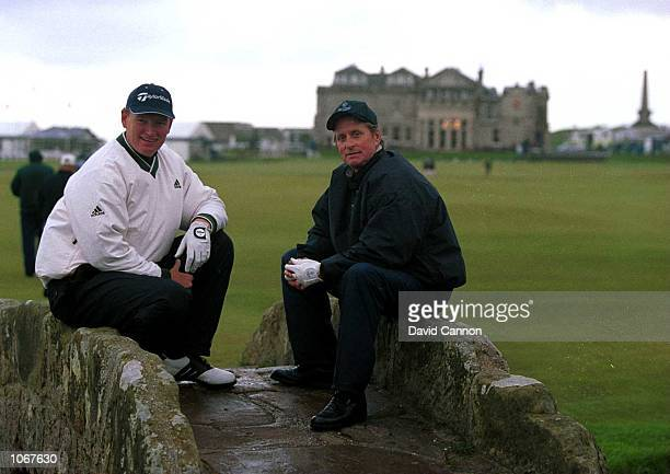 Ernie Els of South Africa and Actor Michael Douglas pose on the Swilken Bridge during the ProAm of the Alfred Dunhill Cup played on the Old Course at...
