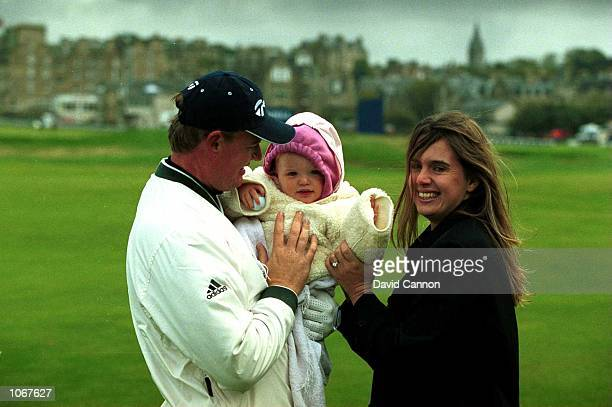 Ernie Els of South Africa holds his child Samantha as his wife Liezl looks on after the ProAm of the Alfred Dunhill Cup played on the Old Course at...