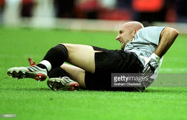 Fabien Barthez rolls on the floor in agony after defeat by Arsenal in the FA Carling Premiership game between Arsenal and Manchester United at...