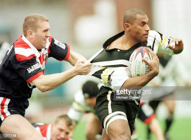 Fiji's Waisale Sovatabua escapes Russia's Matthew Donovan in the Group One match between Fiji v Russia at Craven Park, Barrow. Mandatory...