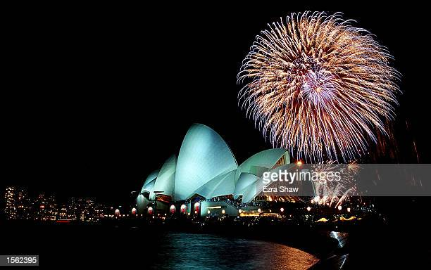 Fireworks light up the Sydney Opera House and skyline to bring the Closing Ceremony to an end during the 2000 Sydney Olympic Games in Sydney...